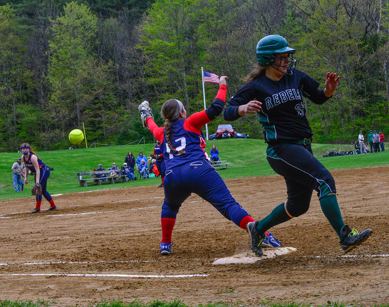 KRISTOPHER RADDER - BRATTLEBORO REFORMER <br /> Hartford's Jordyn Pallmerine could not reach the ball allowing Leland & Gray's Rachel Borgesen to advance to second base during a softball game at Leland & Gray Union Middle and High School on Tuesday, May 9, 2017.