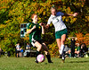 Leland & Gray's Mackenzie Boyle tries to get the ball away from Green Mountain's defender during a girls' varsity soccer match on Wednesday, Oct. 19, 2016. Kristopher Radder / Reformer Staff