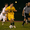Lower Moreland's Casey Pietro looks to pass before Upper Moreland's Tom Kelly can intervene.