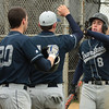 BB_LM Spr_3005<br /> Springfield's Tim Quigg is welcomed home after scoring on an rbi.<br /> Bob Raines 04.10.12