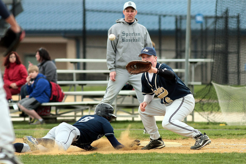 BB_LM Spr_2947<br /> Springfield's Tim Quigg beats the throw to Lower Moreland first baseman Tyler Hunn.<br /> Bob Raines 04.10.12