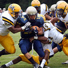 McDevitt's Jacob Jones, left, and Dom Davis bring down Lower Moreland's Oscar Zhang.<br /> Montgomery Media staff photo by Bob Raines<br /> 9/2/11