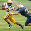 McDevitt's Keith Young fends off Lower Moreland's James Lassiter.<br /> Montgomery Media staff photo by Bob Raines<br /> 9/2/11