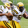 McDevitt defensive back Darren Wright turns up field with an interception behind linebacker Eric Edwards.<br /> Montgomery Media staff photo by Bob Raines<br /> 9/2/11