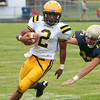 McDevitt's Keith Young escapes tackle by Lower Moreland's James Lassiter.<br /> Montgomery Media staff photo by Bob Raines<br /> 9/2/11