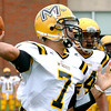 McDevitt quarterback Christian Conner unloads a pass.<br /> Montgomery Media staff photo by Bob Raines<br /> 9/2/11