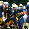 Lower Moreland's Oscar Zhang turns up field  during the season opener against Bishop McDevitt.<br /> Montgomery Media staff photo by Bob Raines<br /> 9/2/11