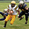 McDevitt's Keith Young turns up field on his way to a touchdown after getting by Lower Moreland's Joe Kehoe.<br /> Montgomery Media staff photo by Bob Raines<br /> 9/2/11