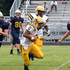 McDevitt's Keith Young gets yardage on a pitch out from quarterback Christian Conner In their season opener against Lower Moreland.<br /> Montgomery Media staff photo by Bob Raines<br /> 9/2/11