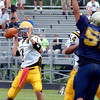 McDevitt quarterback Christian Conner looks for his receiver during the season opener at Lower Moreland.<br /> Montgomery Media staff photo by Bob Raines<br /> 9/2/11