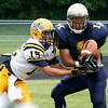 Lower Moreland receiver Robin Choi beats McDevitt defensive back Nick Perez to complete a long pass near the goal line.<br /> Montgomery Media staff photo by Bob Raines<br /> 9/2/11