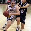 Mount Saint Joseph's Mary Jo Horgan drives to the basket past Villa Maria's Lauren Martinelli.<br /> Bob Raines 2/15/11