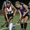 FH_MSJ AC 7549_Mount Saint Joseph's Chrissy Pasacali and Archbishop Carroll's Devyn Marenger battle for the ball.     Photo by Bob Raines