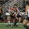 FH_MSJ AC 7487_Archbishop Carroll's Rachael Brosious hits into the center past Mount Saint Joseph's Millie Stefanowicz.    Photo by Bob Raines