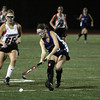 FH_MSJ AC 7463 Mount Saint Joseph's Millie Stefanowicz backhand's the ball as Archbishop Carroll's Maddie Lesher moves to block.     Photo by Bob Raines