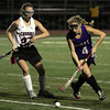 FH_MSJ AC 7509_Mount Saint Joseph's Allie Sabia moves the ball past Archbishop Carroll's Kiera McNulty.     Photo by Bob Raines
