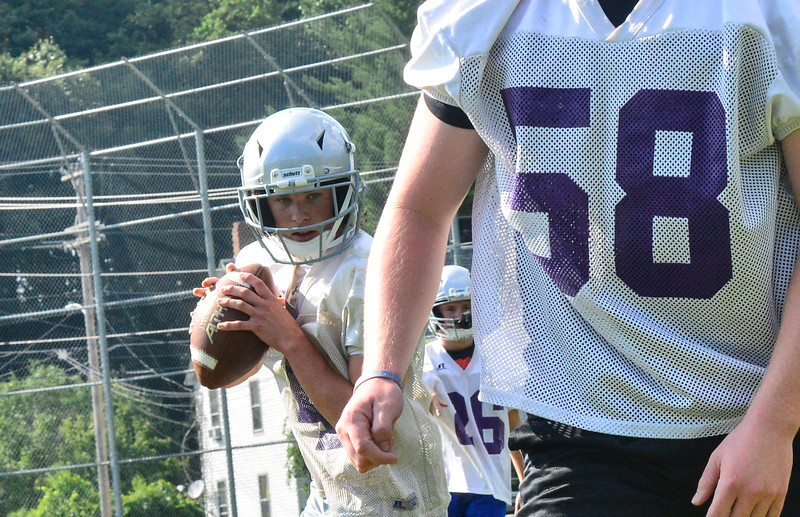 KRISTOPHER RADDER — BRATTLEBORO REFORMER<br /> Brattleboro Henry Thurber takes a snap during the first day of football practice on Monday, Aug. 12, 2019.