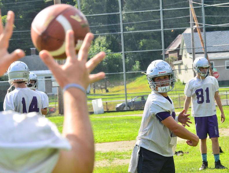 KRISTOPHER RADDER — BRATTLEBORO REFORMER<br /> Brattleboro's quarterback Tyler Millerick tosses the ball during the first day of football practice on Monday, Aug. 12, 2019.