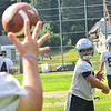 KRISTOPHER RADDER — BRATTLEBORO REFORMER<br /> Brattleboro's quarterback Tyler Millerick tosses the ball during the first day of football practice on Monday, Aug. 12, 2019.