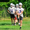 KRISTOPHER RADDER — BRATTLEBORO REFORMER<br /> Members of the Brattleboro Union High School football team take to the practice field during the first day of football practice on Monday, Aug. 12, 2019.