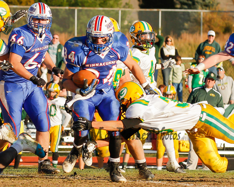 Winnacunnet's #34 Ben Franzoso tries to get past Bishop Guertin's Stavros Anagnost during Saturdays Division II Semifinal game @ Winnacunnet High School on 11-10-2012.  Photo by Matt Parker