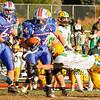 Winnacunnet's #34 Ben Franzoso tries to get past Bishop Guertin's Stavros Anagnost during Saturdays Division II Semifinal game @ Winnacunnet High School on 11-10-2012.  Photo by Matt Parker