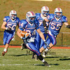 Winnacunnet's #34 Ben Franzoso gets some running room as teammate follow during Saturdays Division II Semifinal game @ Winnacunnet High School on 11-10-2012.  Photo by Matt Parker