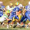 Winnacunnet's Seth Edwards runs behind #55 Jordan Welch while Bishop Guertin's Blake Boudreau gets his hands on him during Saturdays Division II Semifinal game @ Winnacunnet High School on 11-10-2012.  Photo by Matt Parker