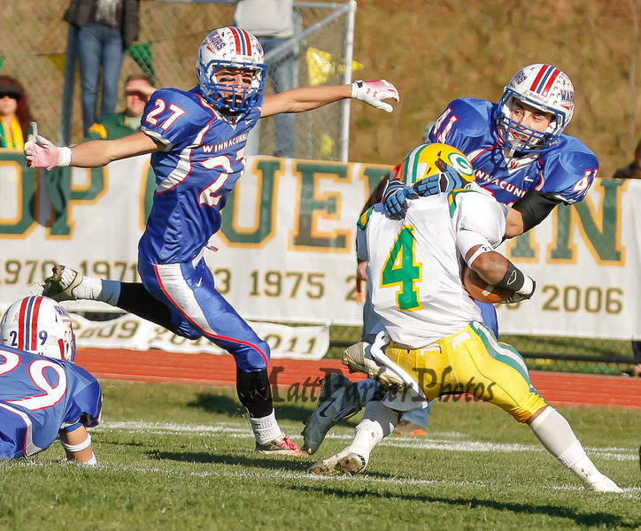 Winnacunnet's #41 Alec Boucher tackels BG's Running Back Clyde Boykin while Winnacunnet's #27 Brandon Gnecco covers during Saturdays Division II Semifinal game @ Winnacunnet High School on 11-10-2012.  Photo by Matt Parker