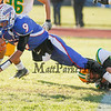 Winnacunnet's Quarterback IngHao Veasna stretches for some valuable yards while Bishop Guertin's Stavros Anagnost grabs  his foot during Saturdays Division II Semifinal game @ Winnacunnet High School on 11-10-2012.  Photo by Matt Parker