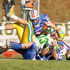 Bishop Guertin's #33 Blake  Boudreau is tackled by Winnacunnet's #32 Sam Bonsaint and #23 Ben Gareau during Saturdays Division II Semifinal game @ Winnacunnet High School on 11-10-2012.  Photo by Matt Parker