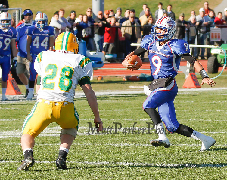 Winnacunnet's Quarterback IngHao Veasna runs the ball while BG's John Miller looks to make a stop during Saturdays Division II Semifinal game @ Winnacunnet High School on 11-10-2012.  Photo by Matt Parker