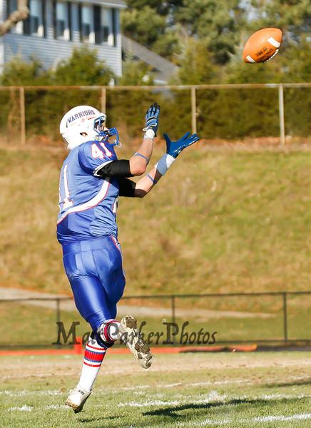 Winnacunnet's #41 Alec Boucher catches a pass thrown by Winnacunnet's Quarterback IngHao Veasna during Saturdays Division II Semifinal game @ Winnacunnet High School on 11-10-2012.  Photo by Matt Parker