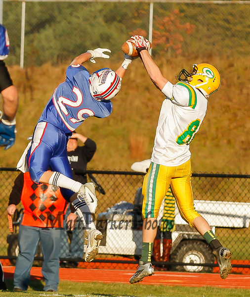 Bishop Guertin's #86 Aidan Loftus makes a catch over Winnacunnet's Clint Felch  during Saturdays Division II Semifinal game @ Winnacunnet High School on 11-10-2012.  Photo by Matt Parker