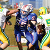 Winnacunnet's Offensive line L to R #54 Jordan Cutting, #55 Ryan Welch, #50 Michael Karpel (hidden), and #37 Seth Edwards protecting Winnacunnet's Quarterback while Bishop Guertin's #70 Patrick Yourell and #58 (no id) defend during Saturdays Division II Semifinal game @ Winnacunnet High School on 11-10-2012.  Photo by Matt Parker