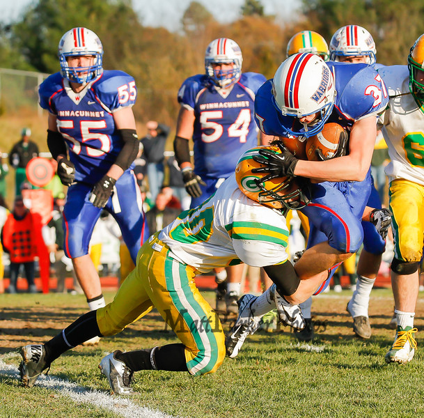 Winnacunnet's #37 Seth Edwards gets tackled by Bishop Guertin's Stavros Anagnost during Saturdays Division II Semifinal game @ Winnacunnet High School on 11-10-2012.  Photo by Matt Parker