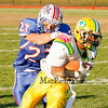 Winnacunnet's #27 Brandon Gnecco gets his hands on Bishop Guertin's Runningback Clyde Boykin during Saturdays Division II Semifinal game @ Winnacunnet High School on 11-10-2012.  Photo by Matt Parker