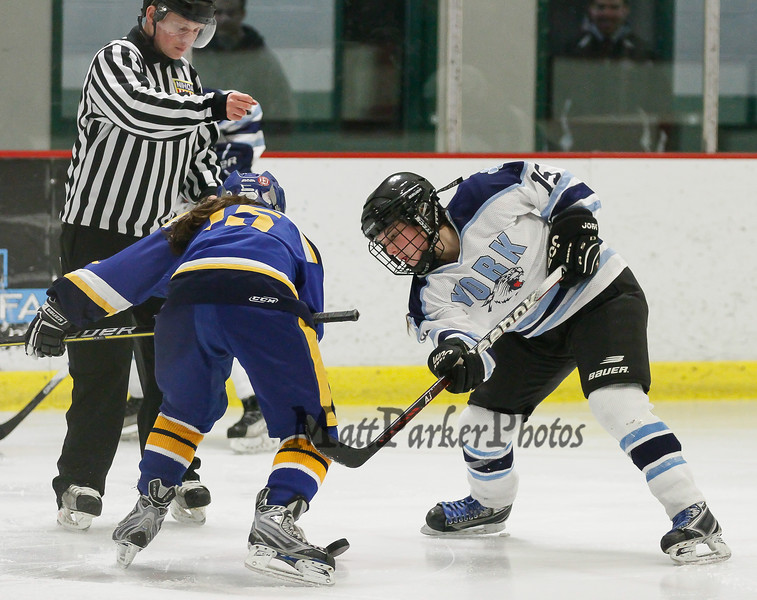 York's #15 Addie Fredette wins a face-off aginst Falmouth's #15 Lucy Meyer during the Girls Hockey Maine Western Conference Semi-Finals with The York Lady Wildcats vs Falmouth Lady Yachtsmen on Monday 2-11-2013 @ The Dover Ice Rinks, Dover NH.  Photo by Matt Parker
