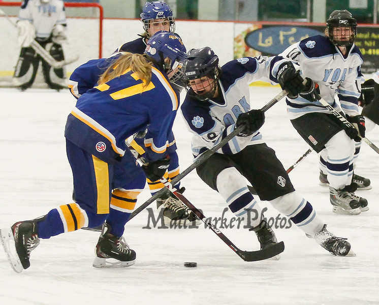 York's #18 Rachel Yorke takes the puck between  Falmouth's #27 Alta Farrell and #13's Gabby St. Angelo while York's #10 Juliann Figlioli trails during the Girls Hockey Maine Western Conference Semi-Finals with The York Lady Wildcats vs Falmouth Lady Yachtsmen on Monday 2-11-2013 @ The Dover Ice Rinks, Dover NH.  Photo by Matt Parker