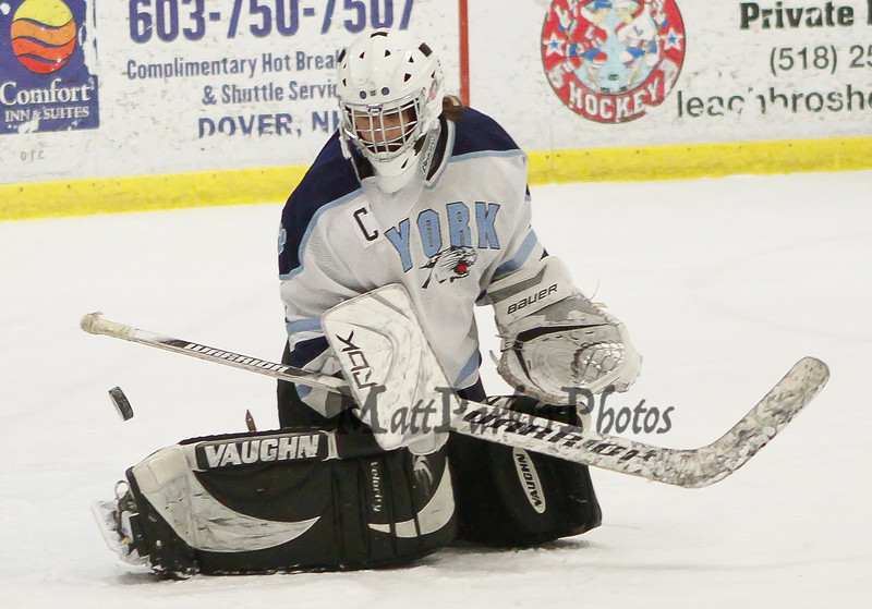 York's Goalie Olivia Drew makes a save during the Girls Hockey Maine Western Conference Semi-Finals with The York Lady Wildcats vs Falmouth Lady Yachtsmen on Monday 2-11-2013 @ The Dover Ice Rinks, Dover NH.  Photo by Matt Parker
