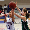 Winnacunnet's Maelan Castro puts back an offensive rebound while Dover's Mercedes McDermott defends during the Division I Girls Basketball game between Winnacunnet HS and Dover HS  on Thursday 2-21-2013.  Photo by Matt Parker