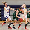 Dover's Molly St. Germain tries to dribble out of a trap set by Winnacunnet's #20 Mimi MacLeod and #22 Paige Wasson during the Division I Girls Basketball game between Winnacunnet HS and Dover HS  on Thursday 2-21-2013.  Photo by Matt Parker
