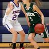Winnacunnet's #23 Rayanne Reusch defends Dover's #5 Katie Boyatsis during the Division I Girls Basketball game between Winnacunnet HS and Dover HS  on Thursday 2-21-2013.  Photo by Matt Parker