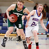 Winnacunnet's Molly Britton puts pressure on Dover's #54 Molly Wotton during the Division I Girls Basketball game between Winnacunnet HS and Dover HS  on Thursday 2-21-2013.  Photo by Matt Parker
