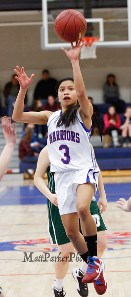 Winnacunnet's Maelan Castro drives the lane during the Division I Girls Basketball game between Winnacunnet HS and Dover HS  on Thursday 2-21-2013.  Photo by Matt Parker