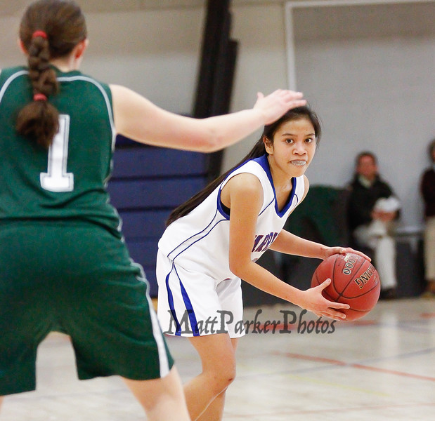 Winnacunnet's Maelan Castro looks to make a pass from the top of the key as Dover's Molly St. Germain defends during the Division I Girls Basketball game between Winnacunnet HS and Dover HS  on Thursday 2-21-2013.  Photo by Matt Parker