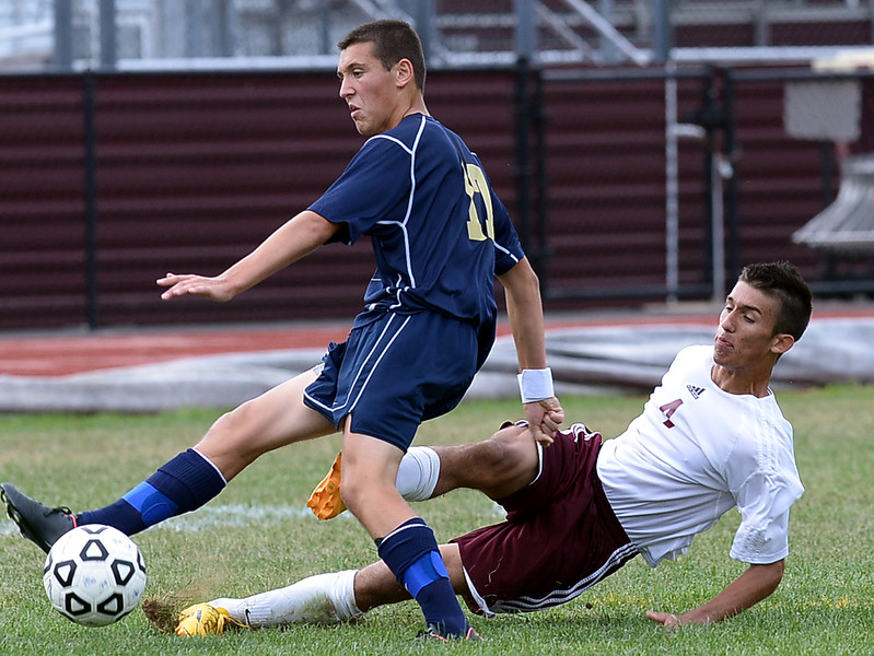 Abington's Juan Castillo tries to tackle Council Rock South's Mike Dowicki during the Sept. 9,2014 game in Schwarzman Stadium. <br /> Montgomery Media staff photo by Bob Raines