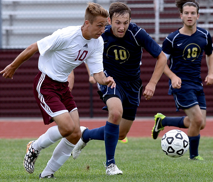Abington's Matt Tracy and Council Rock South's Kevin Maten battle for the ball during the Sept. 9, 2014 game in Schwarzman Stadium.<br /> Montgomery Media staff photo by Bob Raines