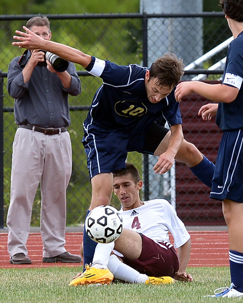 Abington's Juan Castillo and Council Rock South's Kevin Maten get tangled up near the sideline during the Sept. 9,2014 game in Schwarzman Stadium. <br /> Montgomery Media staff photo by Bob Raines
