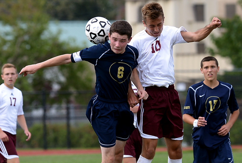 Abington's Matt Tracy and Council Rock South's Brent Weinstein battle for a head ball during the Sept. 9, 2014 game in Schwarzman Stadium.<br /> Montgomery Media staff photo by Bob Raines